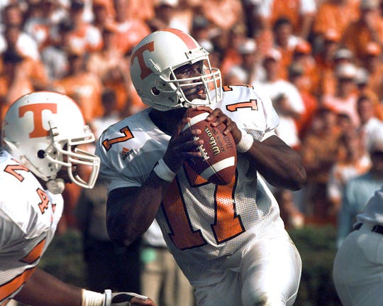 Tennessee quarterback Tee Martin falls back to pass just before he was hit hard and taken out of the game against Auburn for a couple of plays.