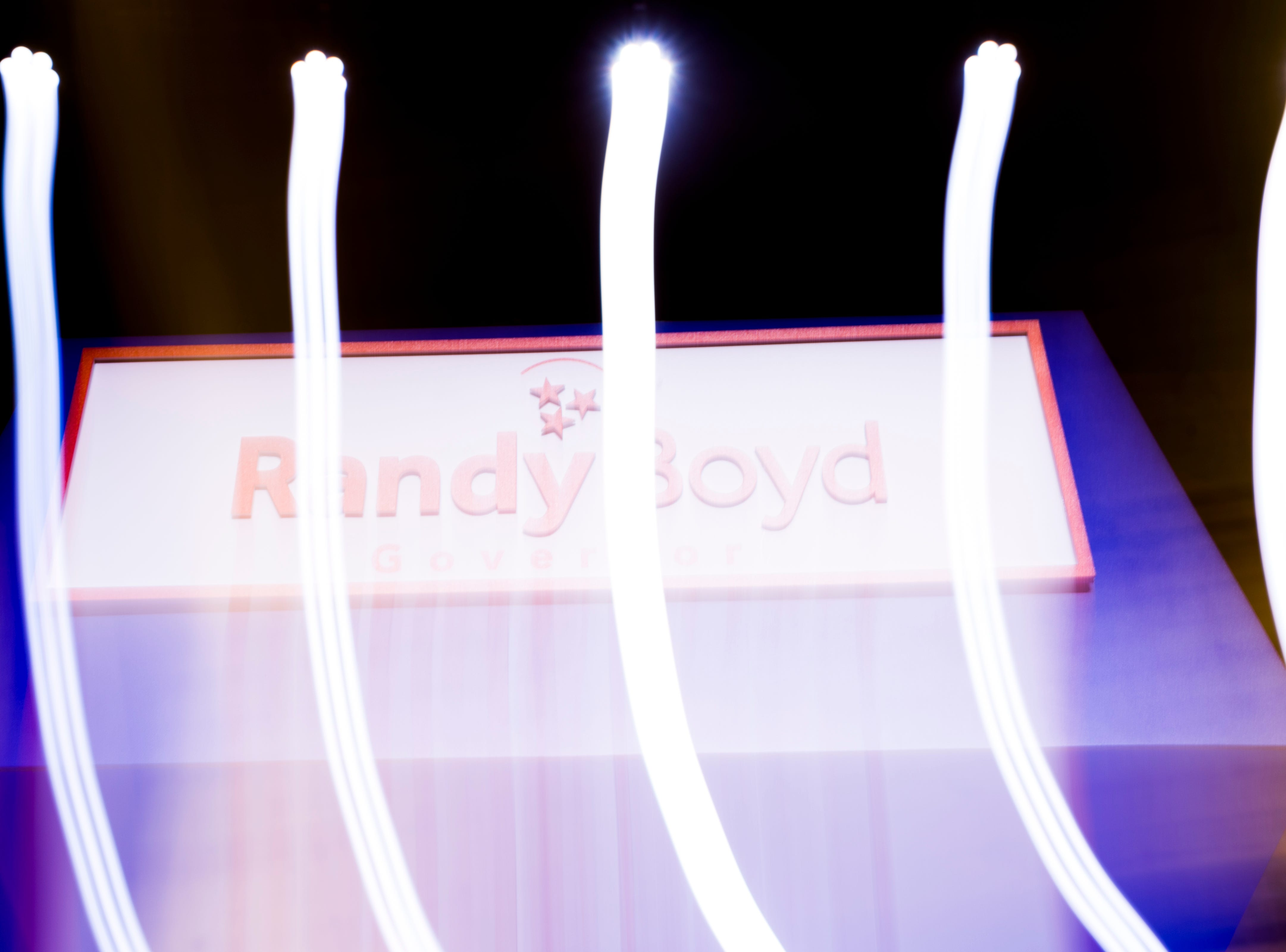 The Randy Boyd logo is seen in this long-exposure photograph at the Randy Boyd for Governor watch party at Jackson Terminal in Knoxville, Tennessee on Thursday, August 2, 2018.