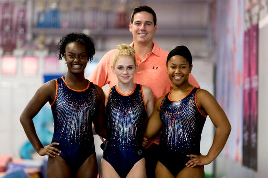 From left, Tia Taylor, Savanna Cecil, coach Eric Thomas and Ayanna Albright pose during practice at Premiere Athletics in Knoxville, Tennessee on Friday, July 27, 2018. They will represent Team USA in Russia this November.