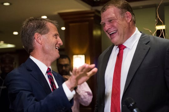 Tim Burchett speaks to Glenn Jacobs at the Crowne Plaza on election day in Knox County Thursday, Aug. 2, 2018.