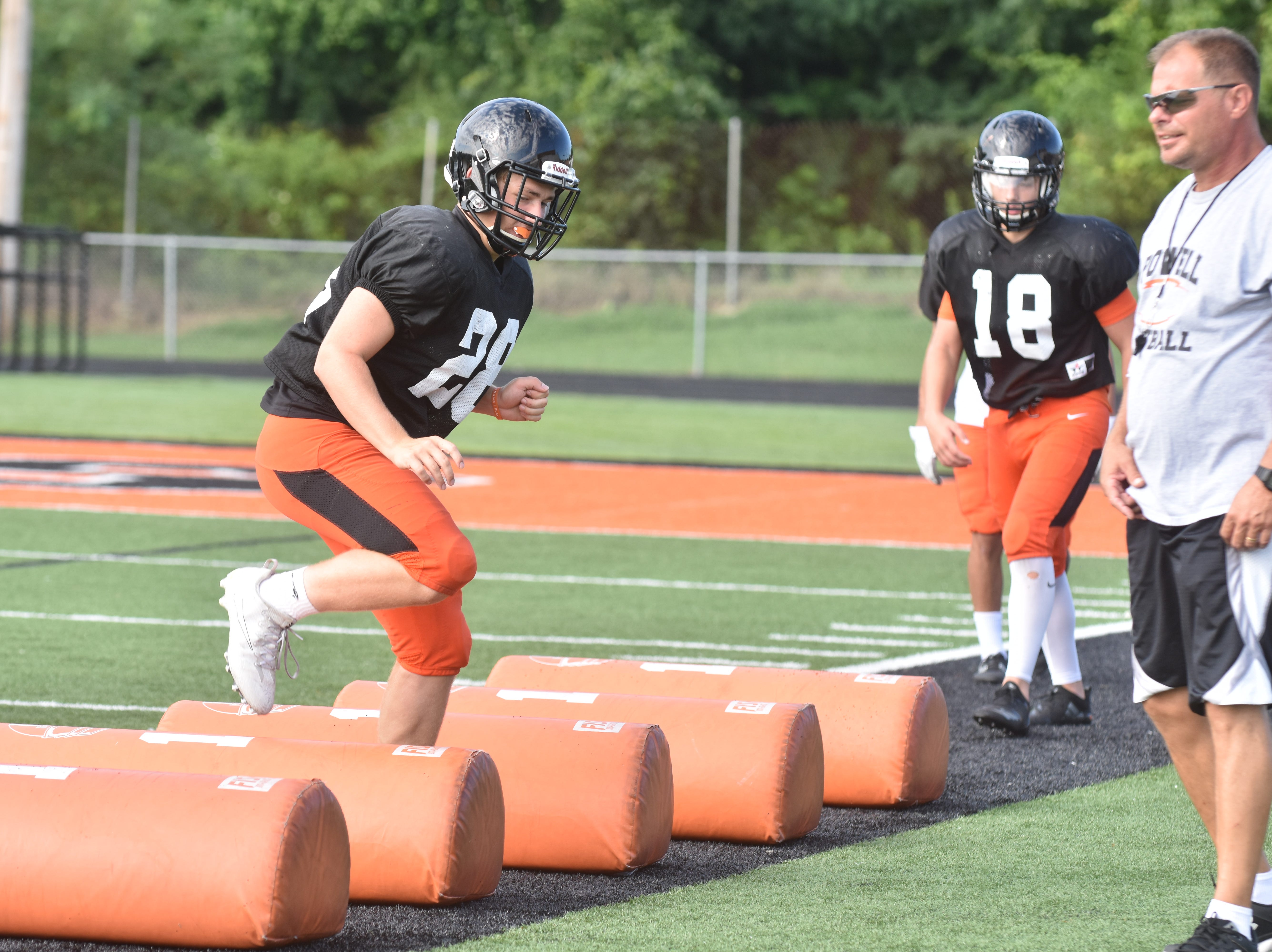 Powell football team members run through drills under the close supervision of the coaching staff during practices.