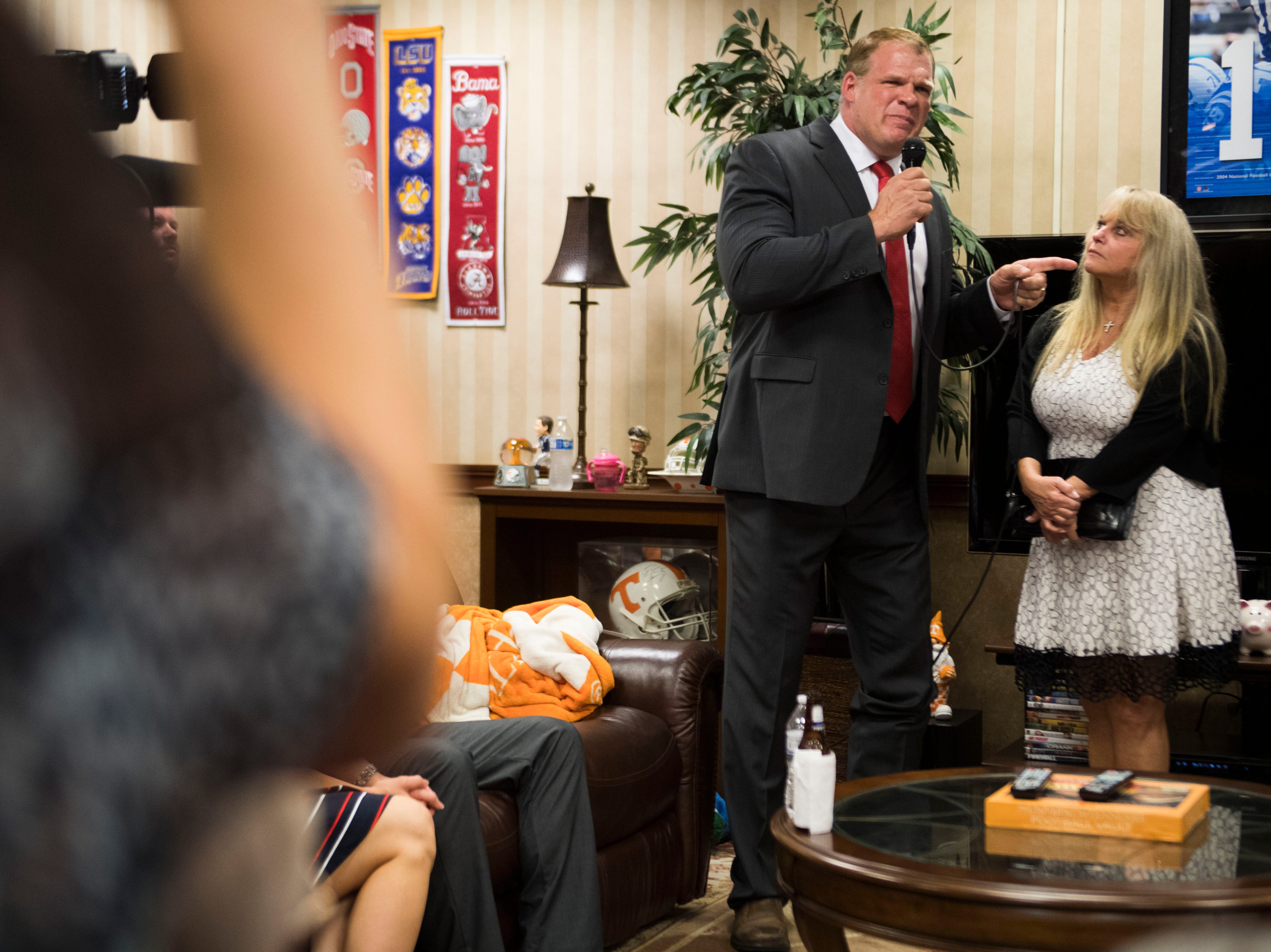 Glenn Jacobs speaks to a crowd after early results call him Knox County Mayor, next to his wife Crystal at the Crowne Plaza on election day in Knox County Thursday, Aug. 2, 2018.