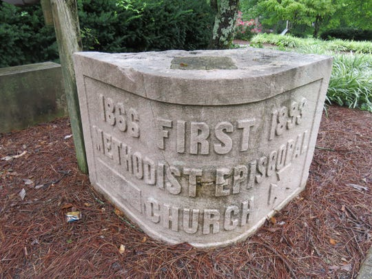 A cornerstone from former downtown church sits outside current First United Methodist Church off Kingston Pike.
