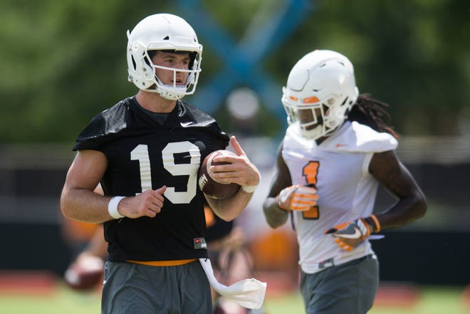Quarterback Keller Chryst runs on the field during the first Vols football practice of the season Friday, Aug. 3, 2018.