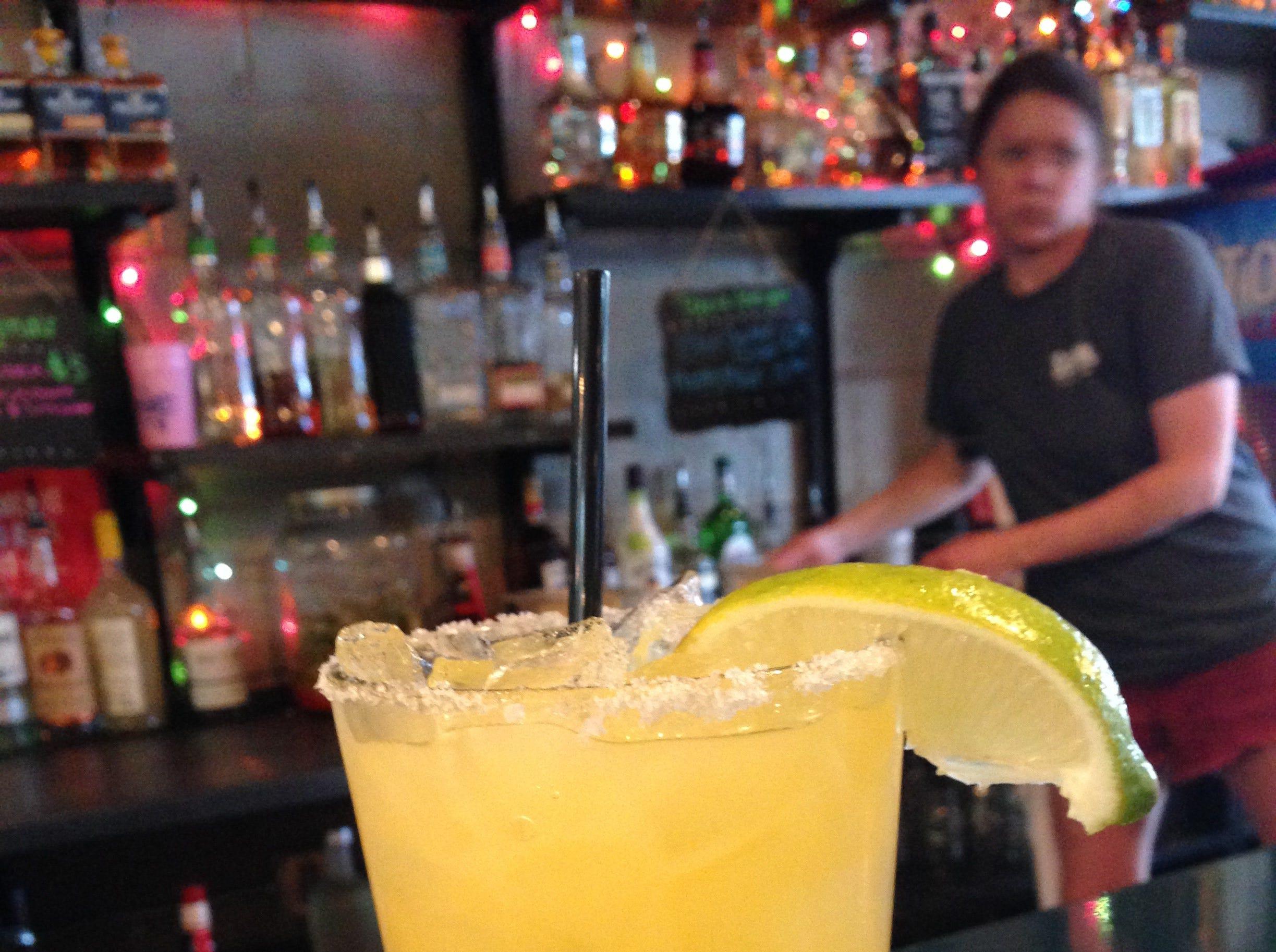 Bartender Beth Wolfe in action behind the bar at SoKno Taco Cantina, Aug. 2, 2018.