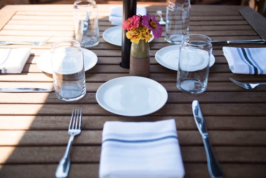 A table is set at the Walnut Kitchen's new rooftop patio in Maryville on Thursday, July 26, 2018.