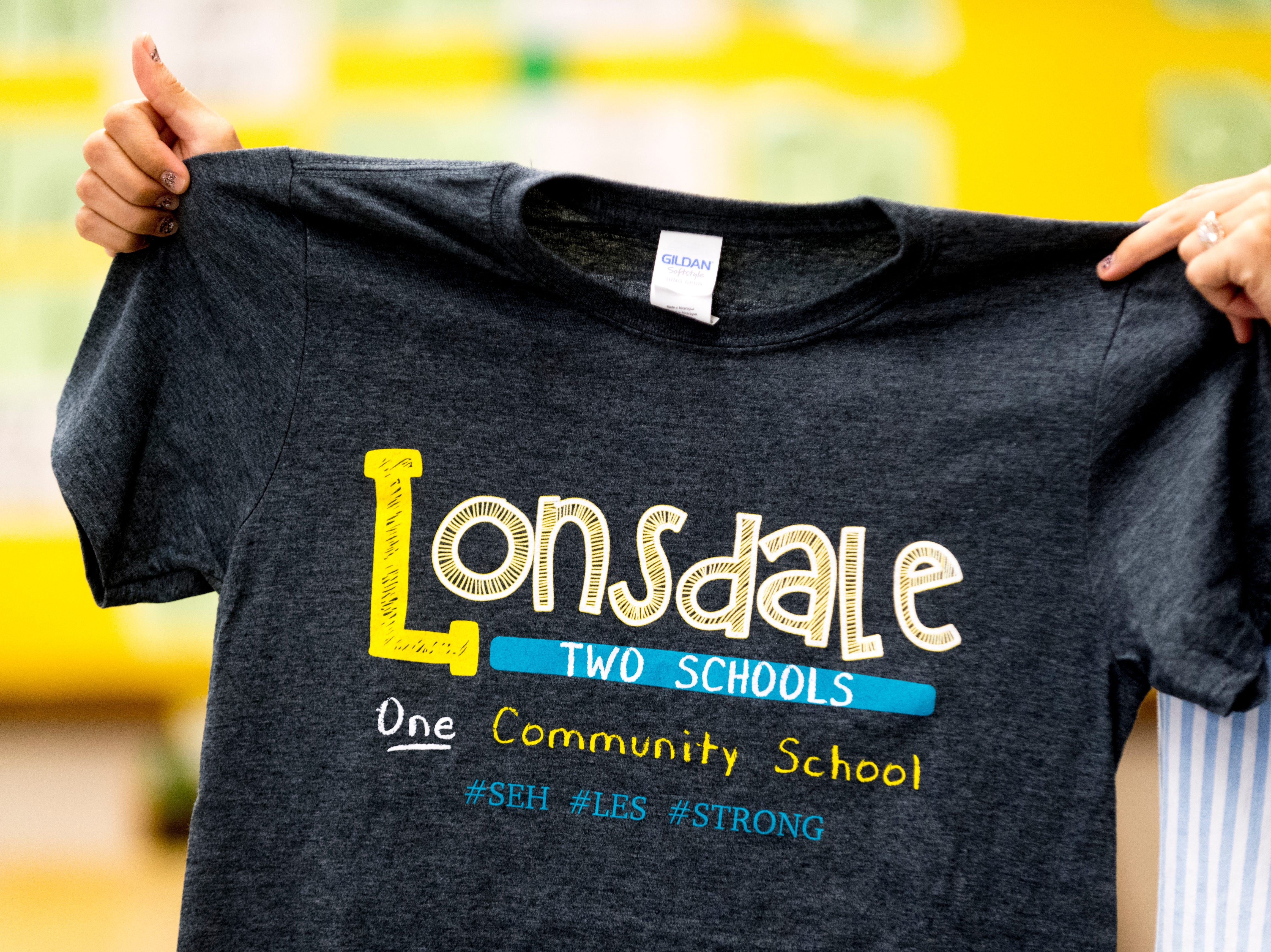 Kindergarten teacher Patricia Galicki's holds a Lonsdale t-shirt at Sam E. Hill Primary School in the Lonsdale community in Knoxville, Tennessee on Friday, August 3, 2018. The school has newly transitioned from a preschool into a primary school.