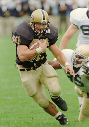 Purdue's Mike Alstott (40) scrambles past Notre Dame's Corey Bennett (95) during a 1995 game in Ross-Ade Stadium.