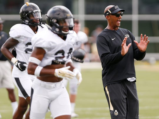 Cornerbacks coach Derrick Jackson shouts instructions to players during football practice Friday, August 3, 2018, at Purdue.