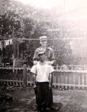This photograph shows Lancaster Jim Bowes with a young Japanese man who work in U.S. military compound Bowes unit was stationed in.