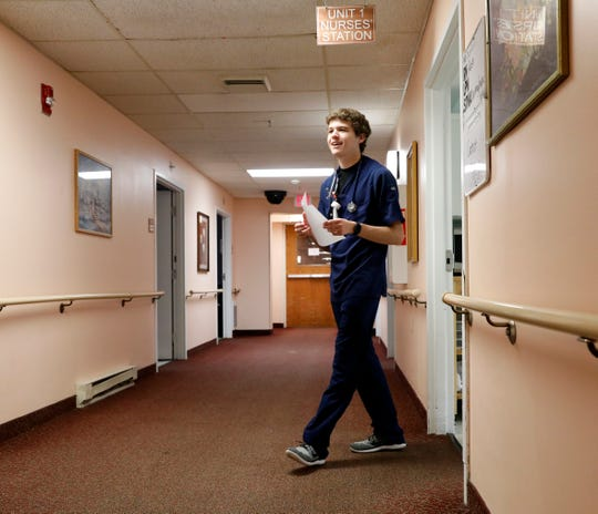 Joseph Swingle walks out of a nurses station Thursday night, Aug. 3, 2018, at Crestview Rehabilitation and Skilled Nursing in Lancaster. Swingle graduated from Mid-East Career and Technology Centers in Zanesville this year and recently passed his board exams to become a licensed practical nurse. In June he won the National Skills Competition in nursing in Louisville, Kentucky.