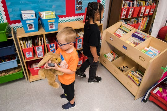 Madison Dulin checks out the library and Noah Gill plays with a timer in Anna Pfister's kindergarten class during Kindergarten Camp at Eisenhower Elementary School in Louisville, KY on Friday, August 3, 2018.