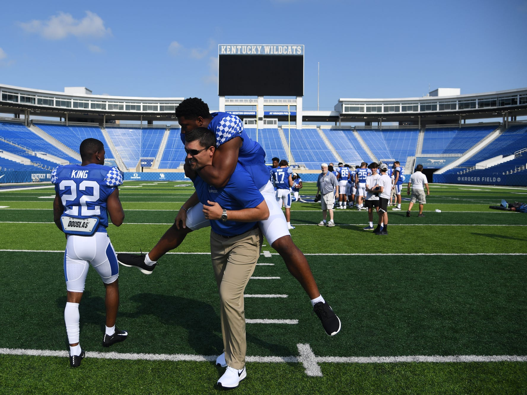 LB Josh Allen gets a ride from inside linebackers coach Brad White during the UK football media day at Kroger Filed in Lexington, Kentucky on Friday, August 3, 2018.
