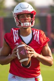 University of Louisville quarterback Jordan Travis prepares to throw during team's morning practice.August 03, 2018