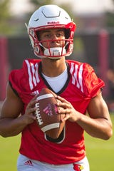 University of Louisville quarterback Jordan Travis prepares to throw during team's morning practice.