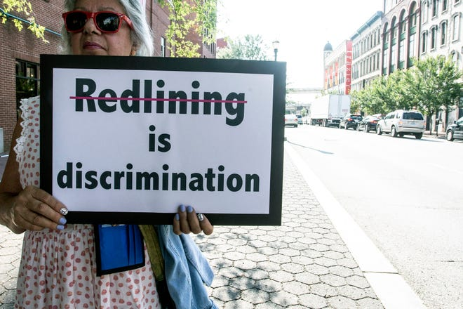 Redlining was the issue as a group from the Presbyterian Women in the PC(USA) marched on Friday to west of 9th Street. 8/3/18