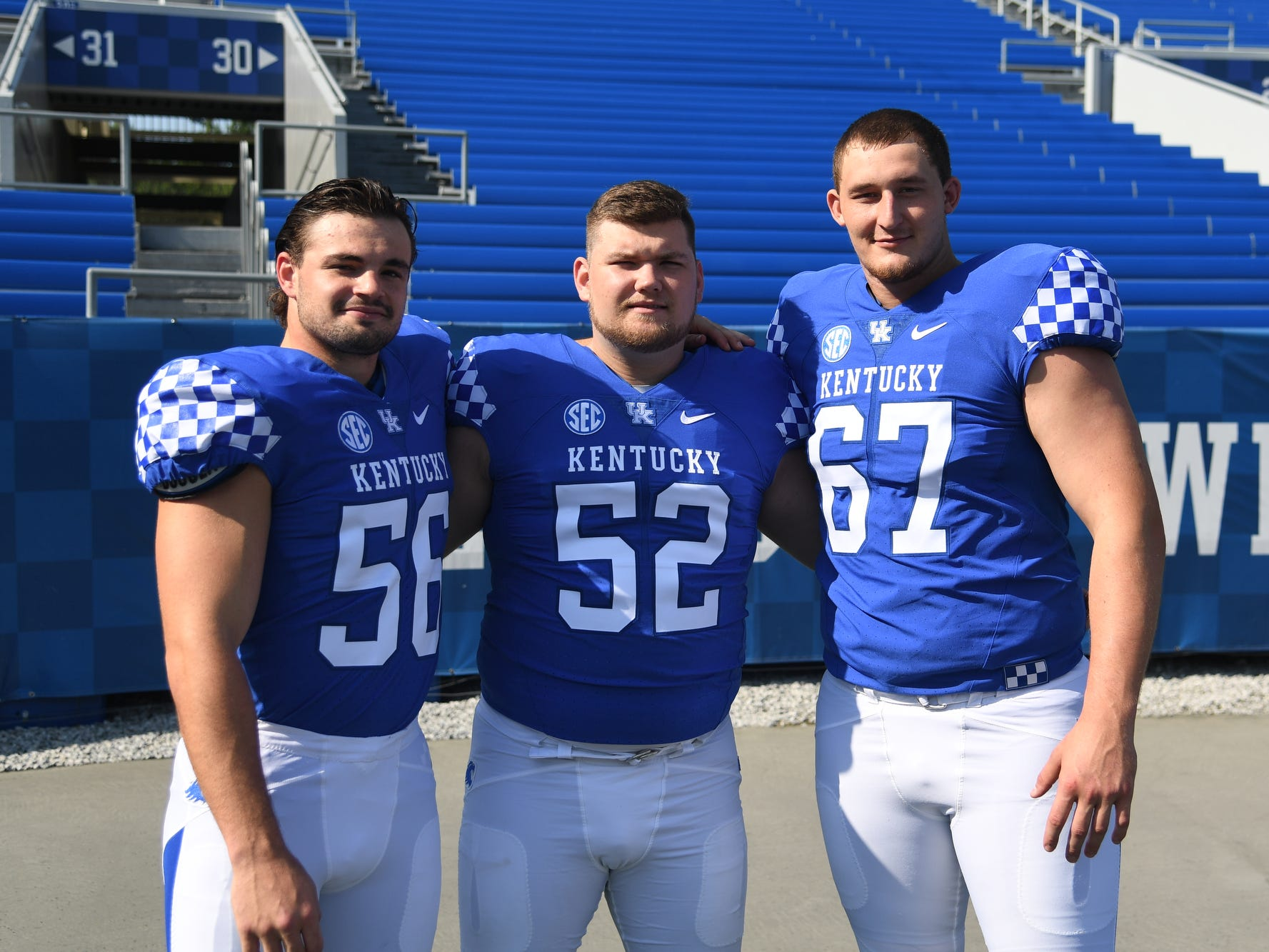 LB Kash Daniel, C Jackson Drake and OT Landon Young during the UK football media day at Kroger Filed in Lexington, Kentucky on Friday, August 3, 2018.