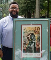 Official Poster Artist, K.O. Lewis, at unveiling of 2018's St. James Court Art Show poster.