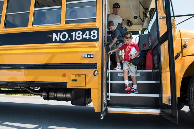 Hudson Payton, 5, and his twin brother Nolyn Payton, 5, departs the school bus on a mini field trip to the Southwest Branch of the Louisville Free Public Library during Kindergarten Camp at Eisenhower Elementary School in Louisville, KY on Friday, August 3, 2018.