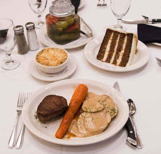 Glazed carrot served with filet mignon and skillet potatoes at Bob's Steak and Chop House at the Omni Hotel on Thursday, July 19, 2018.