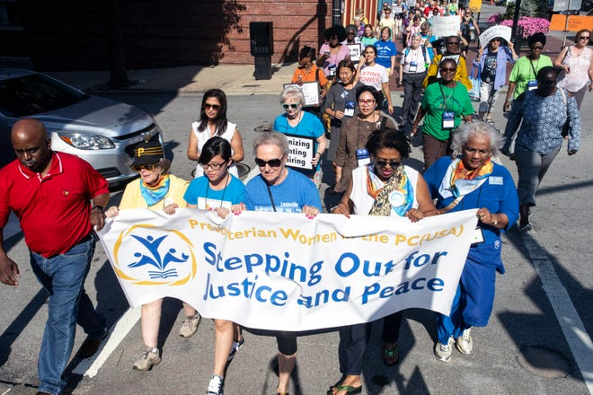 A march west along Main Street on Friday afternoon was organized by the Presbyterian Women in the PC(USA) to bring attention to Louisville's redlining policies that created the so called 9th Street divide years ago. 8/3/18