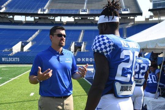 Inside linebackers coach Brad White instructs DE Kengera Daniel during the UK football media day at Kroger Filed in Lexington, Kentucky on Friday, August 3, 2018.