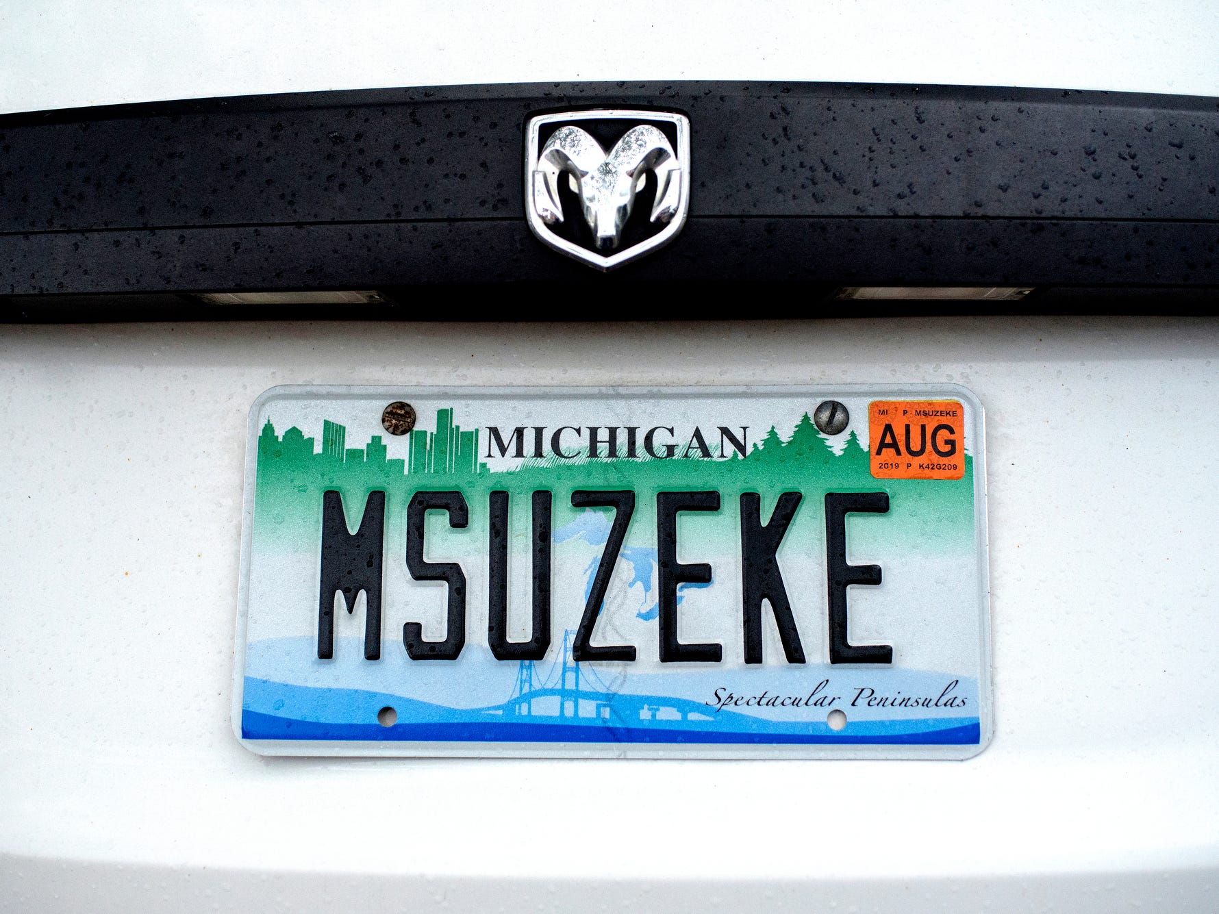 Caretaker Jim Foley's custom license plate reads 'MSUZEKE,' named for Zeke the Wonderdog IV.