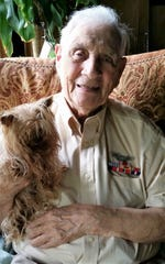 "William ""Bill"" Wynne, 96, served in the United States Army Air Force during WWII. He is pictured with his dog, Smoky II."