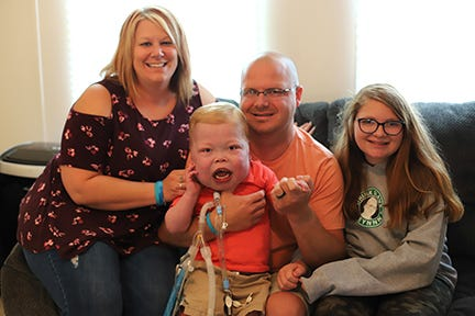 Cayden and his family, from left, mother Gretchen, fatherKevin holding Riley, and sister Riley.