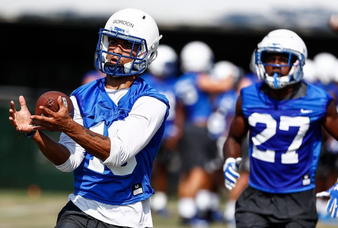 The University of Memphis defensive back Tim Gordon (left) during the first day of practice for the 2018-19 season.