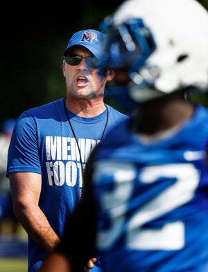 University of Memphis head coach Mike Norvell (left) watches his players during the first day of practice for the 2018-19 season.