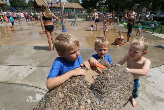 Jack Adams (left), Alex Adams and Fischer Paul play with the water fountain at the Lake Country Rotary Splash Pad in Nixon Park in Hartland. In addition to the new restaurants and businesses in the downtown area, the village also added the splash pad to the park in 2013 and Endter's Sports Grill will host a beer garden nearby for the third season this summer.