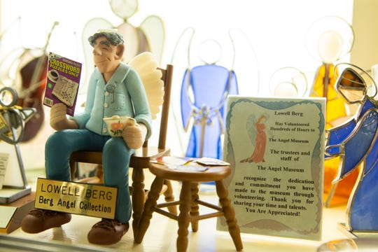 After Lowell's death in 2003, Joyce placed an angel figure of her husband in a backlit case in his memory.