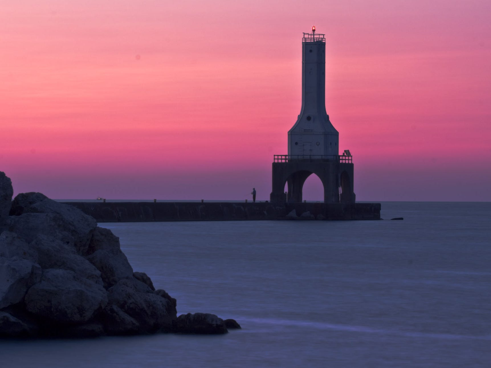 Pier and lighthouse at dawn. Another treat for lighthouse fans is the art deco lighthouse at the end of the town pier. Built in 1935, it is one of only two lighthouses of this design. Photo from Port Washington Tourism Council