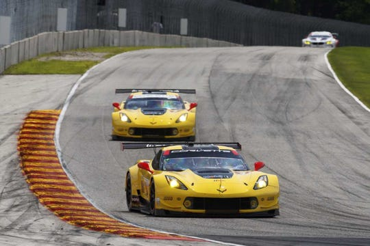 The two Corvette Racing GT Le Mans cars reach Road America's Turn 5.