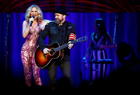 Jennifer Nettles, left, and Christian Bush of the duo Sugarland perform during a show at Bridgstone Arena Thursday, Aug. 2, 2018 in Nashville, Tenn.