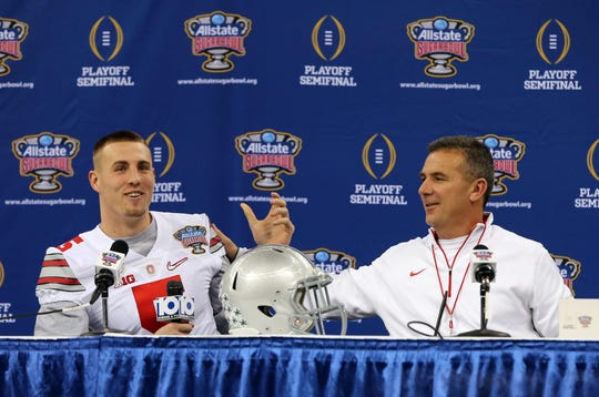 Ohio State Buckeyes tight end Jeff Heuerman (5) interviews head coach Urban Meyer during Sugar Bowl media day at the Mercedes-Benz Superdome.