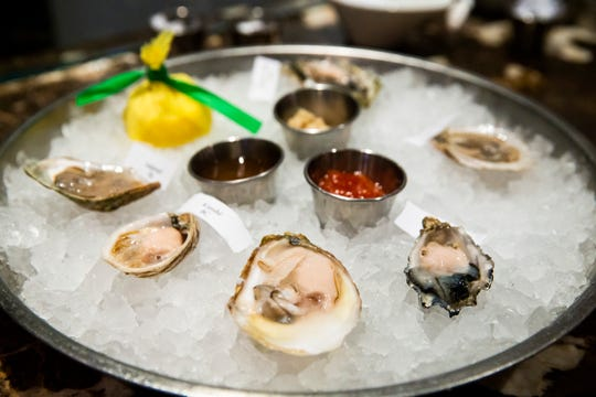 A freshly shucked oyster platter at Sea Salt in downtown Naples on Thursday, August 2, 2018.