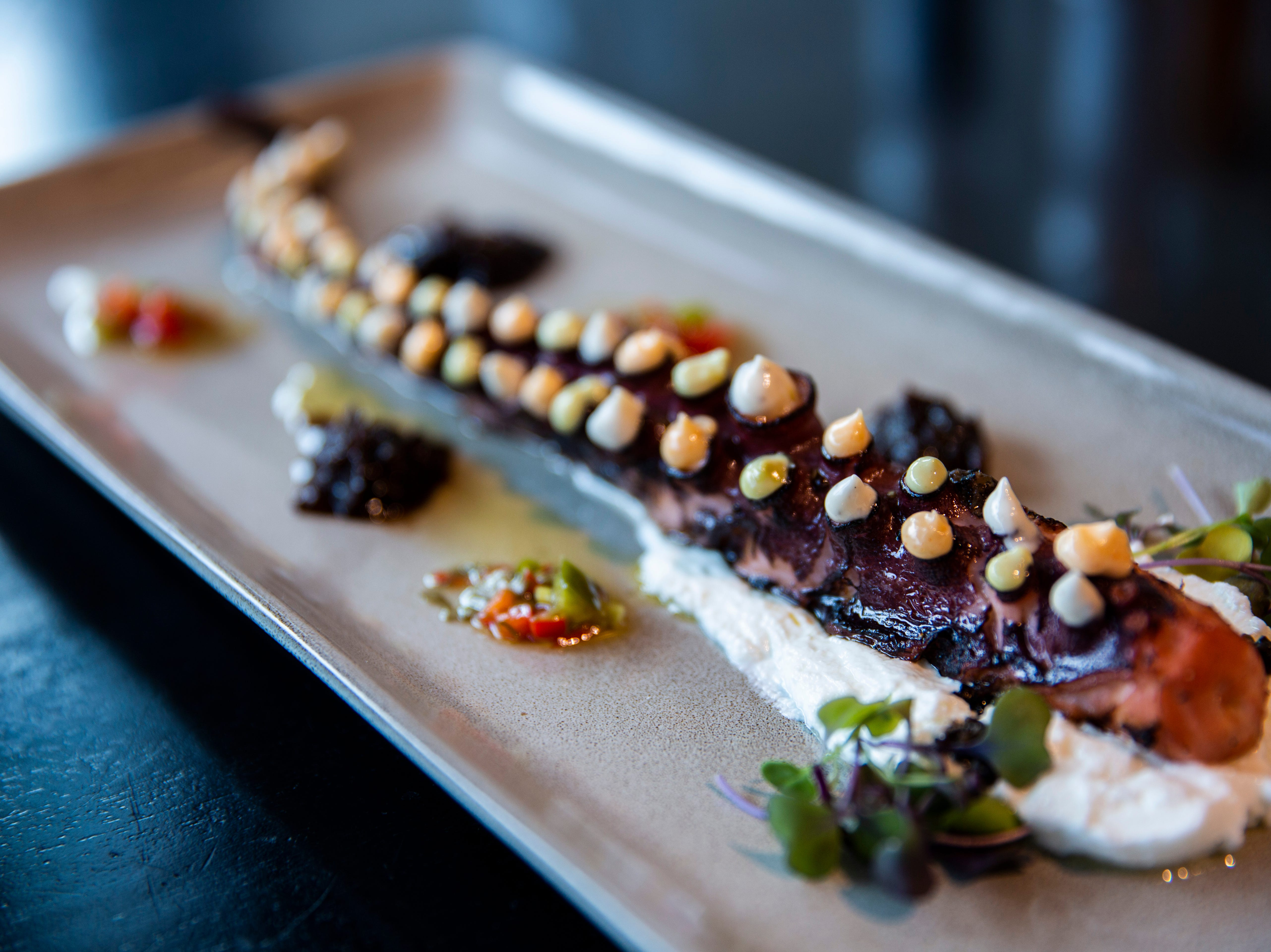 The Charred Octopus dish at Dorona comes with burrata, black truffle, smoked paprika, and caramelized onion jam.