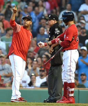 Aug 3, 2018; Boston, MA, USA; Boston Red Sox manager Alex Cora (20) argues with umpire Adam Hamari (78) during the first inning against the New York Yankees at Fenway Park.
