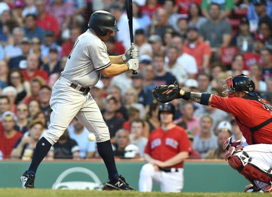 Aug 3, 2018; Boston, MA, USA; New York Yankees left fielder Brett Gardner (11) gets hit by a pitch during the first inning against the Boston Red Sox at Fenway Park.