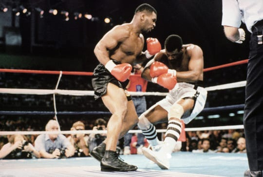 Michael Spinks is seen as he goes down after receiving a knockout by Mike Tyson during their 91-second heavyweight fight, June 27, 1988 at Trump Plaza in Atlantic City. (AP Photo/Richard Drew)