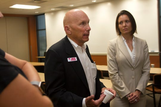 At center, New Mexico Senator candidate Mick Rich talks with local leaders and business people, Thursday, Aug. 2, 2018 at San Juan College School of Energy in Farmington.