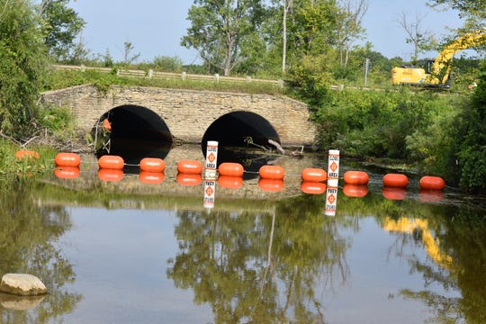 The bridge on Wixom Road over the Huron River is being replaced.