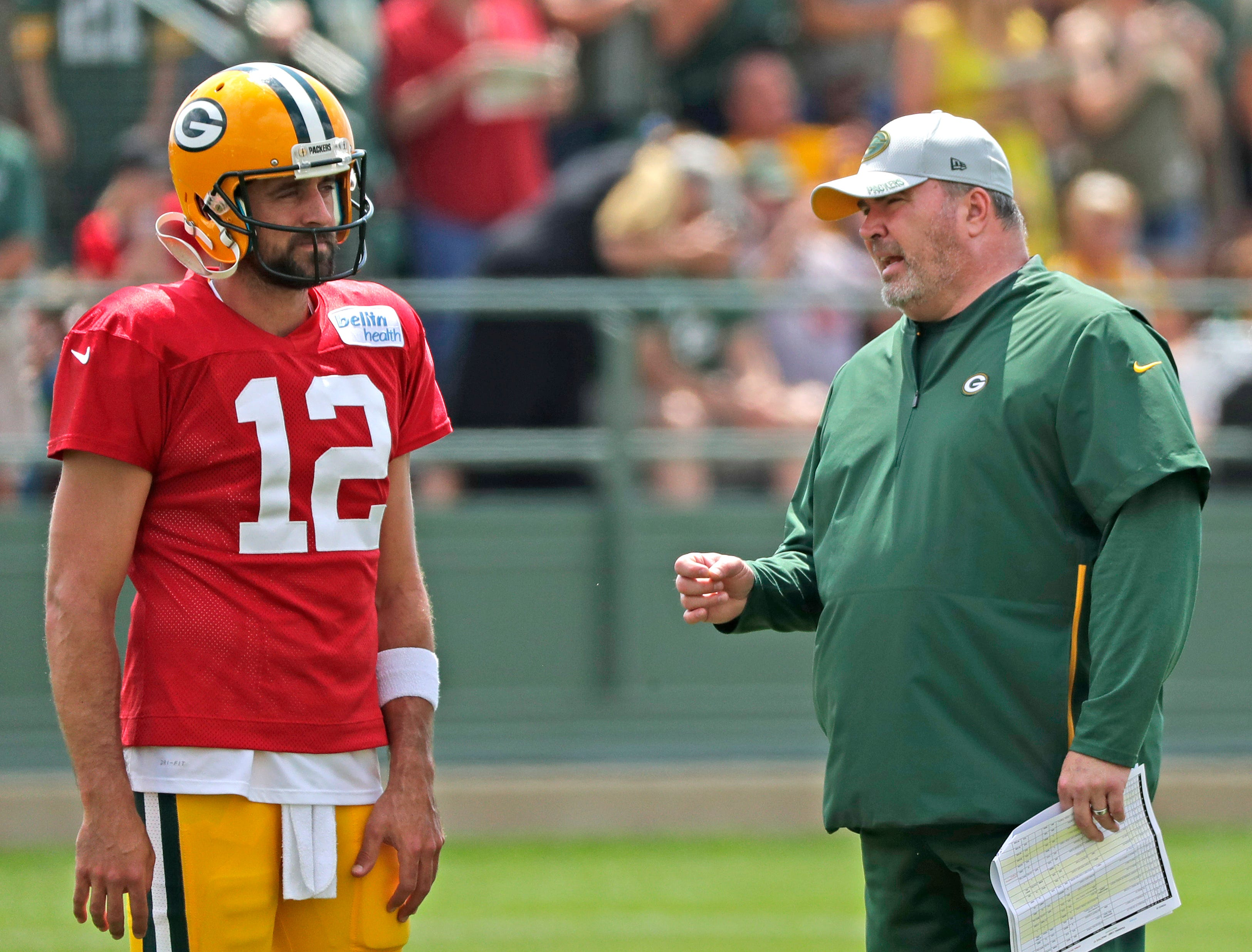 Green Bay Packers quarterback Aaron Rodgers (12) talks to head coach Mike McCarthy during training camp practice at Ray Nitschke Field on Friday, August 3, 2018 in Ashwaubenon, Wis. 