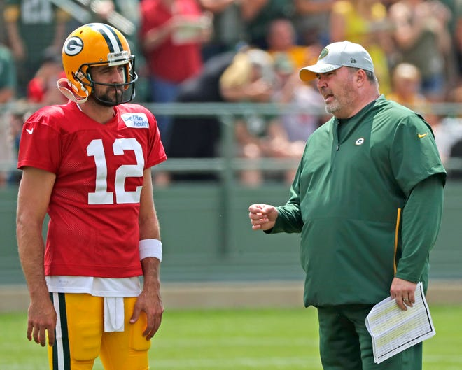 Green Bay Packers quarterback Aaron Rodgers (12) talks to head coach Mike McCarthy during training camp practice at Ray Nitschke Field on Friday, August 3, 2018 in Ashwaubenon, Wis. Adam Wesley/USA TODAY NETWORK-Wisconsin