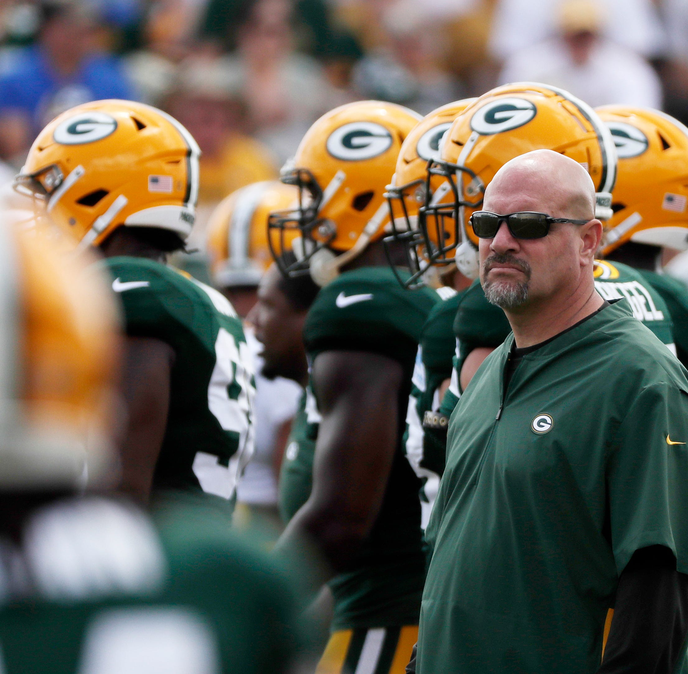 Green Bay Packers defensive coordinator Mike Pettine watches during training camp practice at Ray Nitschke Field on Friday, August 3, 2018, in Ashwaubenon, Wis.
