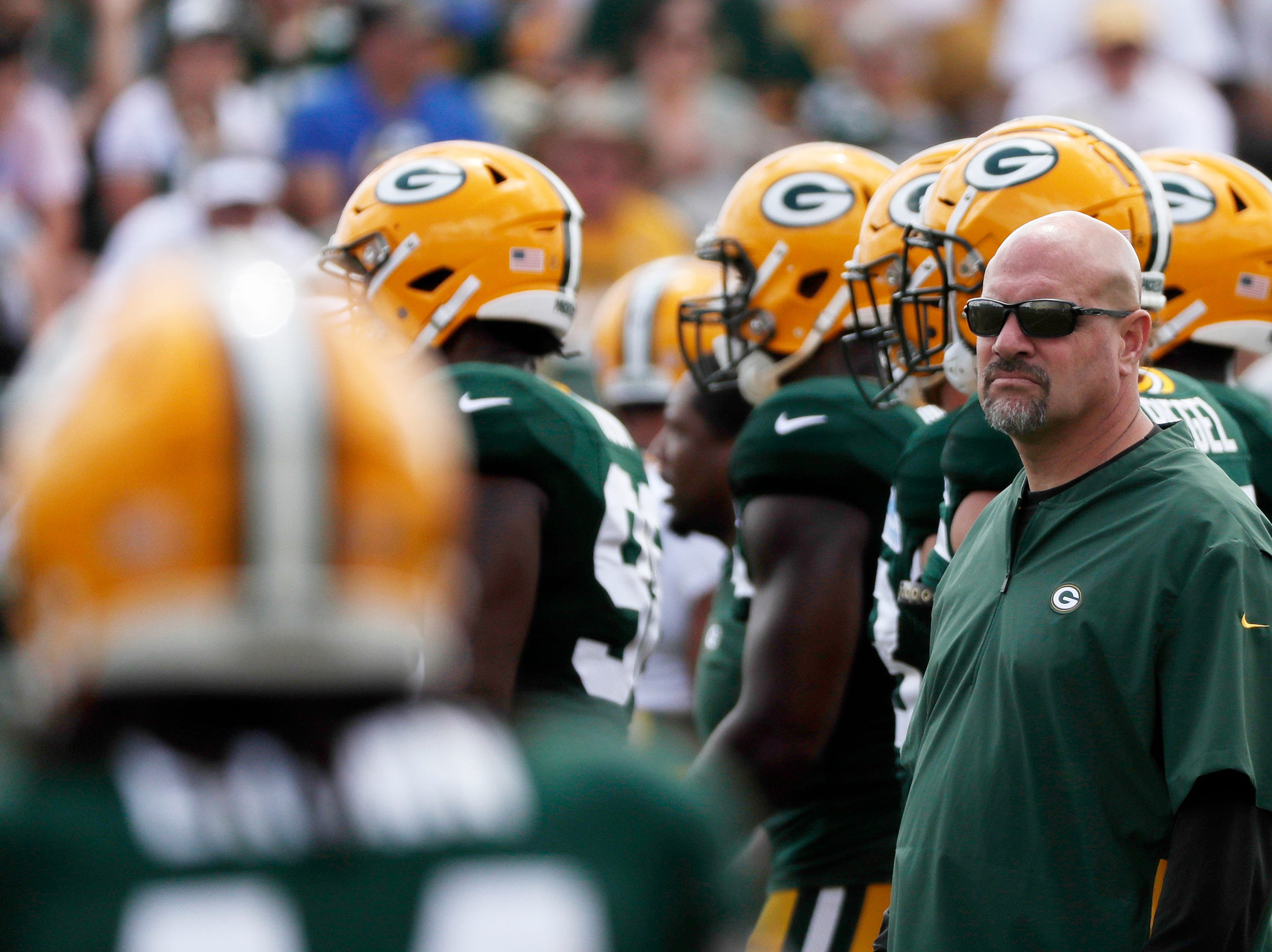 Green Bay Packers defensive coordinator Mike Pettine watches during training camp practice at Ray Nitschke Field on Friday, August 3, 2018 in Ashwaubenon, Wis. 