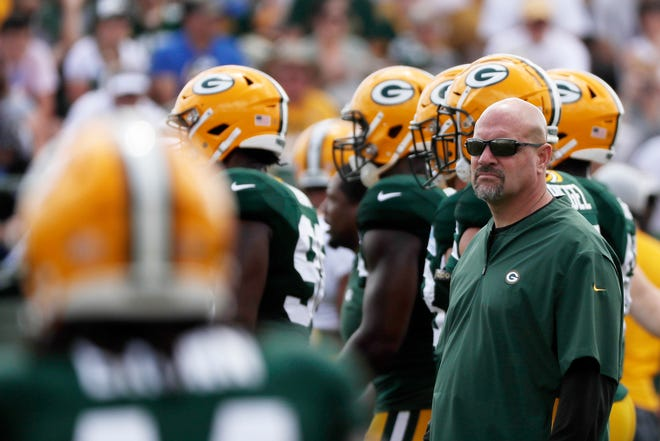 Packers defensive coordinator Mike Pettine watches during a training camp practice.