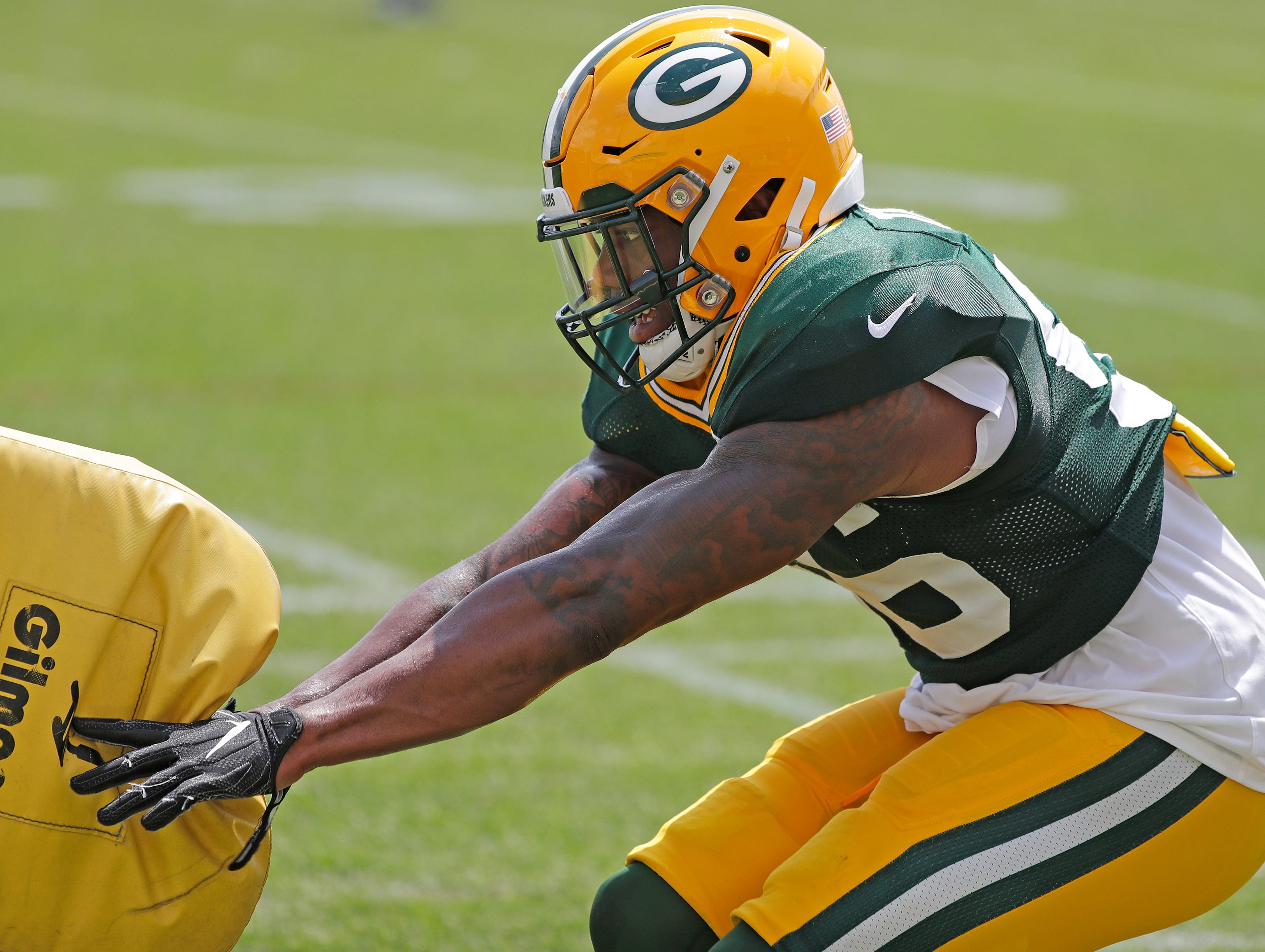 Green Bay Packers linebacker Ahmad Thomas (56) runs through a hitting drill during training camp practice at Ray Nitschke Field on Friday, August 3, 2018 in Ashwaubenon, Wis. 